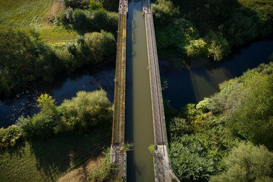 An 19th century aqueduct crosses the Savoureuse river, Belfort, Bourgogne-Franche-ComtÔøΩ, France