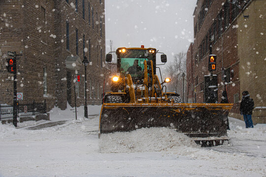 Truck removing snow from the streets of Montreal during winter.