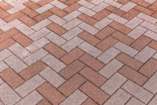 Vintage brown cobblestone pavement pattern and background