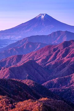 The view of Mount Fuji and the mountain range in the autumn during sunrise. As seen from Mt. Gangaharasuri , Mount Gangaharasuri in the Okuchichibu Mountains, Japan