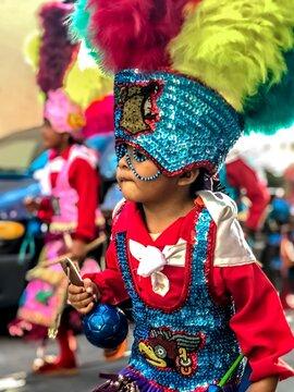 Boy Wearing Costume Enjoying At Carnival In City