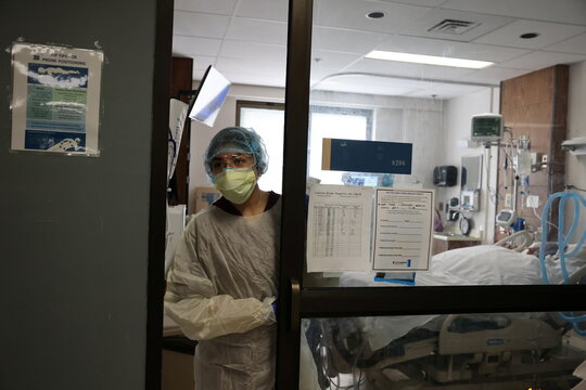 Registered nurse Erika Aguilar, 31, attends to a patient in the COVID-19 intensive care unit, as the global outbreak of the coronavirus disease (COVID-19) continues, at Providence Saint Joseph Medical Center in Burbank