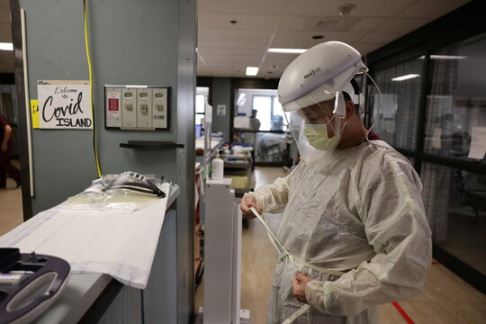 Registered nurse Vincent Encarnacion, 45, suits up to attend to a patient in the COVID-19 intensive care unit, as the global outbreak of the coronavirus disease (COVID-19) continues, at Providence Saint Joseph Medical Center in Burbank