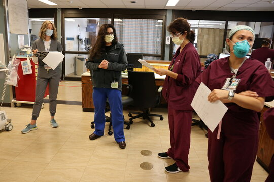 Dr Mariam Torossian briefs her team in the COVID-19 intensive care unit, as the global outbreak of the coronavirus disease (COVID-19) continues, at Providence Saint Joseph Medical Center in Burbank