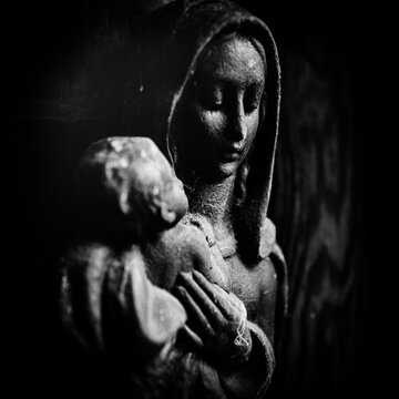 Close-up Of Virgin Mary Figurine