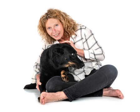beauceron and woman