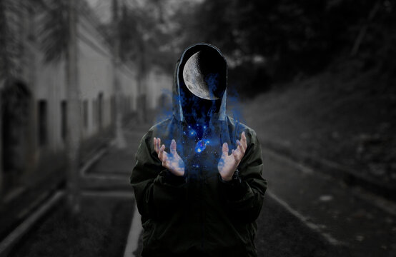 Digital Composite Image Of Man In Hooded Shirt With Moon And Galaxy On Road