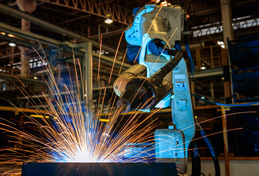 Low Angle View Of Robot Welding At Factory