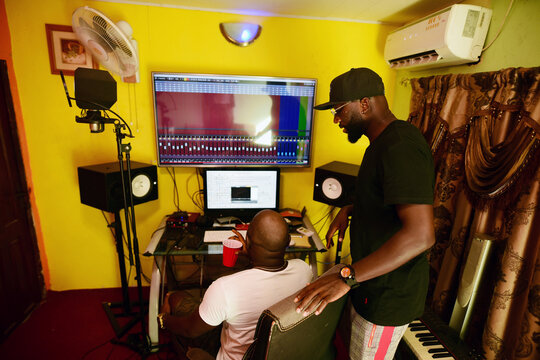 Sierra Leonean musician Emmerson Bockarie watches as an engineer mixes one of the songs at a studio in Freetown,