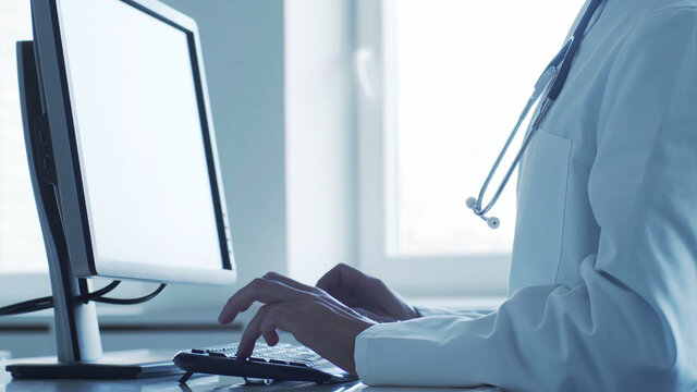 Professional medical doctor working in hospital office using computer technology. Medicine and healthcare.