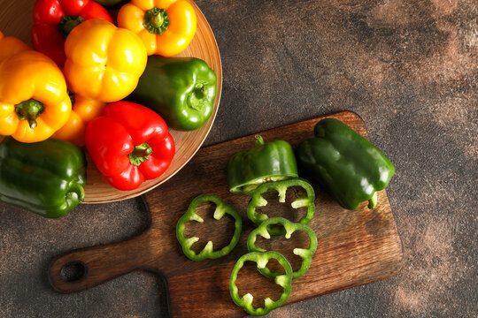 Composition with fresh bell peppers on table
