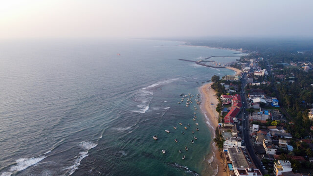 Aerial view of the ocean and the town of Hikkaduwa, Sri Lanka