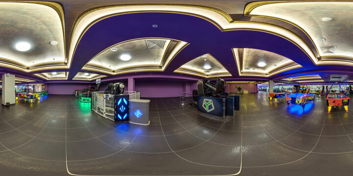 MINSK, BELARUS - MARCH 4, 2015: Panorama in interior of Children entertainment center with slot machines.  Full 360 by 180 degree seamless spherical panorama in equirectangular equidistant projection.