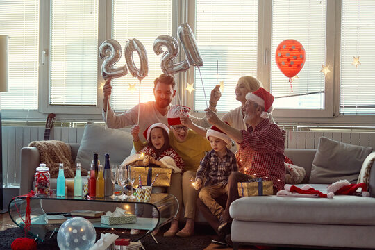 Happy family enjoying New Year eve together. New Year, holiday, family time together
