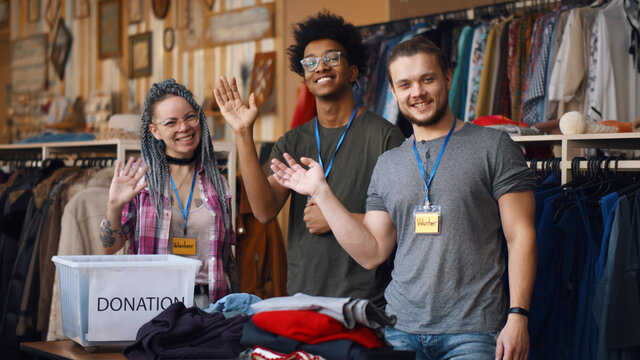 Portrait of young diverse volunteer group with clothes for donation