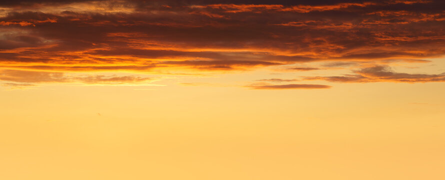 panorama of cloudscape at sunset with red clouds and copyspace