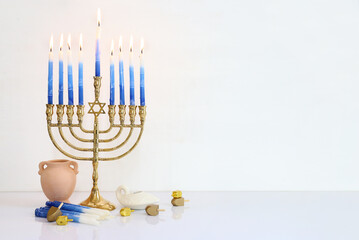 Religion image of jewish holiday Hanukkah background with menorah (traditional candelabra) and...