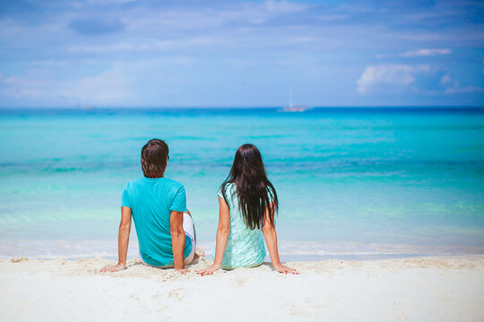Young couple on white beach during summer vacation.