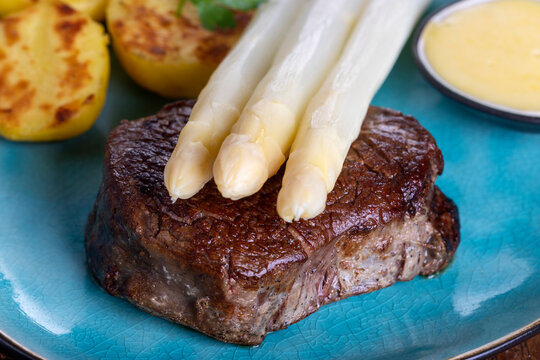 asparagus with potatoes and a steak