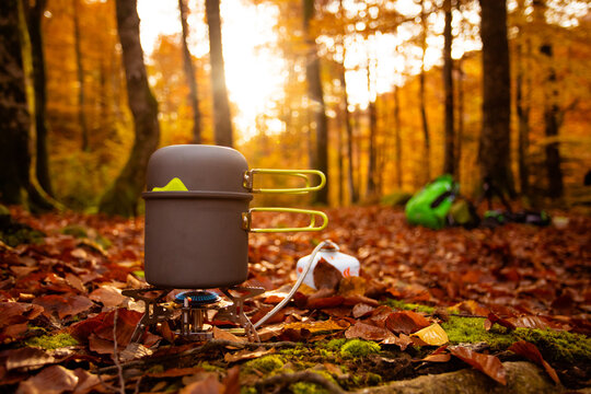 Cooking hot dish to warp up while autumn hiking