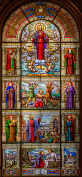 TURIN, ITALY - MARCH 16, 2017: The scens from live of apostle St. Jude Taddheus in the stained glass of church Chiesa di San Massimo designed by prof. Mario Barbieris.