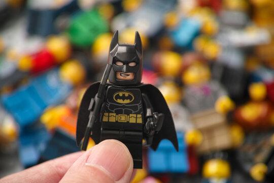 Tambov, Russian Federation - November 17, 2020 Lego Batman minifigure being held in a hand.