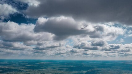 Fotobehang - Beautiful high altitude clouds over summer ocean landscape. Aerial drone hyperlapse, 4K UHD.