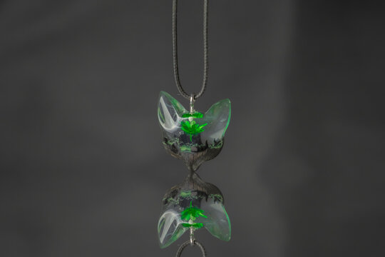 Jewelry work combining different and creative handmade epoxy and woodwork