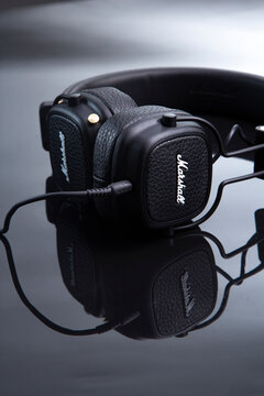 Marshal headphones on a black glossy table close-up. Belgorod , Russia - jun, 16, 2020: