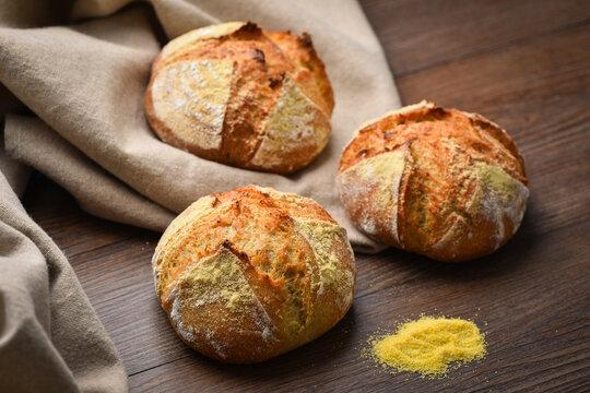 Delicious homemade  Corn Sourdough bread on the wooden plate