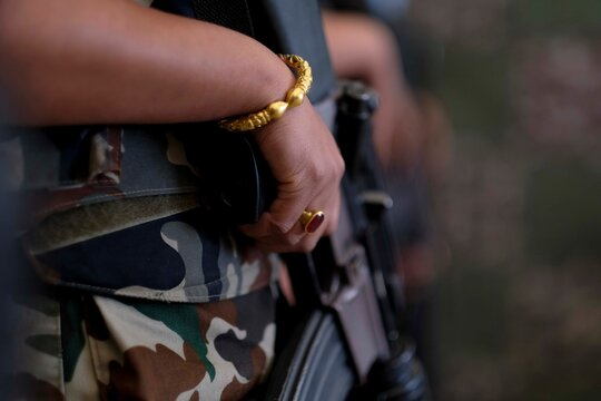 Midsection Of Female Soldier With Rifle