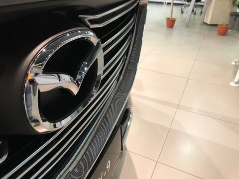 MOSCOW, RUSSIA - NOVEMBER 10, 2020. Mazda emblem on the new car grill