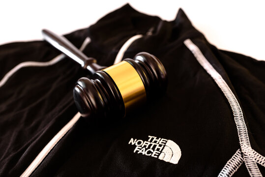 Valencia, Spain - November 18, 2020: Emblem of the American company The North Face with a gavel for their problems with justice.