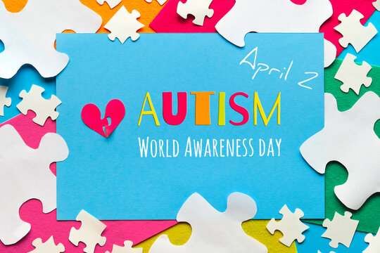 Creative design for Autism World day, April 2. Panoramic awareness banner, hands hold red heart.