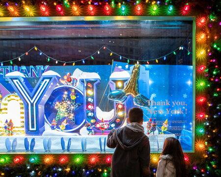 Children watch the Christmas window of the Macy's Herald Square store in New York City, New York