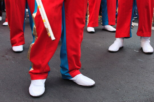 Low Section Of Men In Marching Band On Street