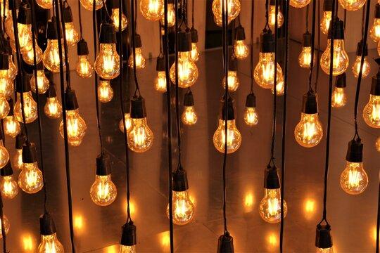 Full Frame Shot Of Illuminated Light Bulbs Hanging At Night