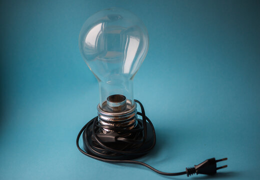 Close-up Of Light Bulb On Blue Background