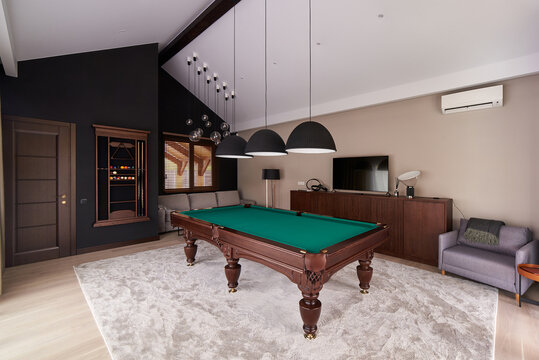 modern billiard room with a beautiful table and large windows