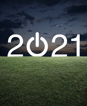 2021 start up business flat icon with green grass field over sunset sky, Happy new year 2021 cover concept