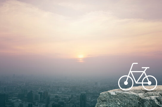 Bicycle flat icon on rock mountain over aerial view of cityscape at sunset, vintage style, Business healthy lifestyle concept