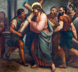 VIENNA, AUSTIRA - OCTOBER 22, 2020: The painting Jesus carries his cross as part of Cross way station in church St. Johann der Evangelist by Karl Geiger (1876).