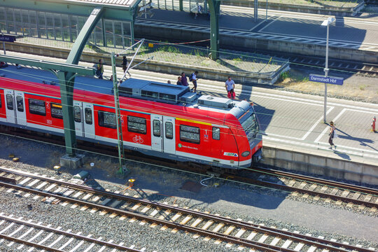 Commuter train at a station and with commuters