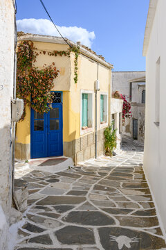 Street with typical Greek architecture in Lefkes village on Paros island