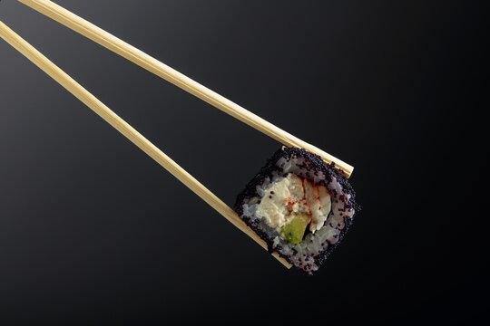 Fresh tasty sushi with smoked eel and black caviar.