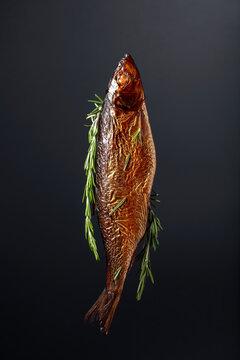 Smocked herring on a black background.