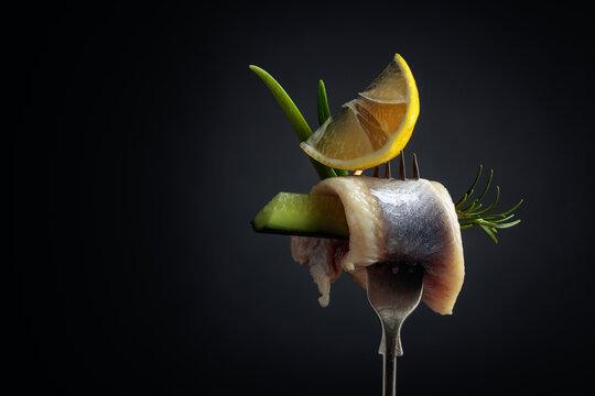 Atlantic herring with lemon, green cucumber, onion and rosemary.