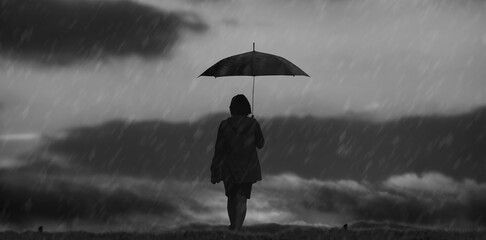 Fotomurales - The girl's silhouette walking alone outdoor and umbrella in rain black and white.