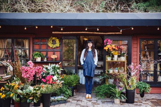 Flower shop owner in storefront