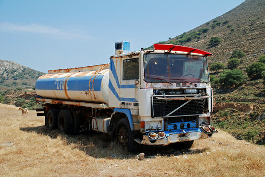 An old Revoil fuel tanker lorry parked in the hills of the Greek island of Tilos on June 19, 2019. The Athens based petroleum company was founded in 1982.